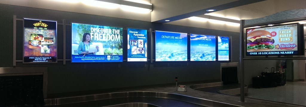 Duratran Posters displayed in light box at the Pensacola airport baggage claim.