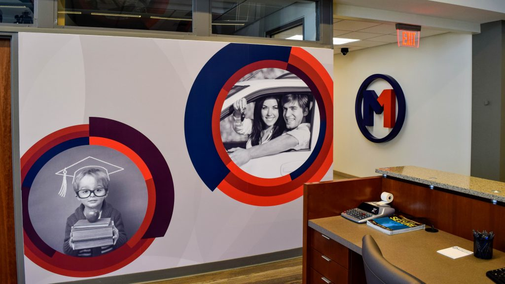 Members First branded graphics near reception desk