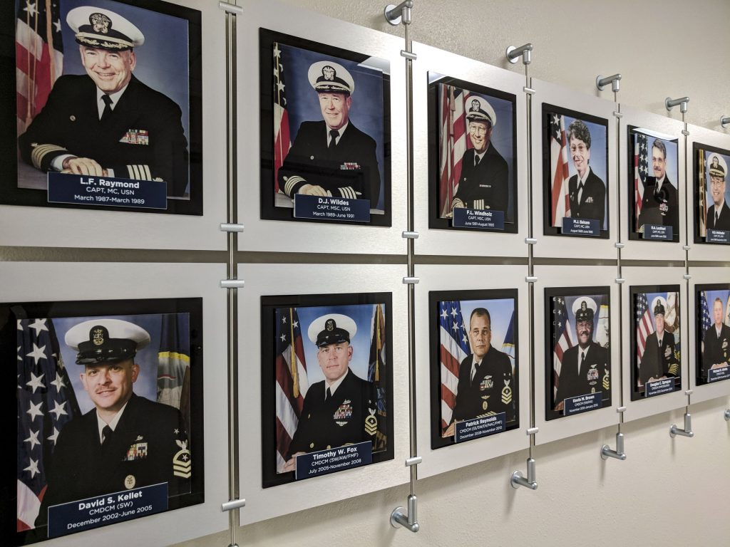 Employee recognition wall display for Naval Hospital Pensacola. Built and installed by signgeek.