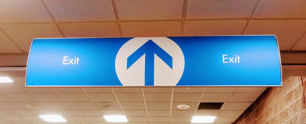 Interior directional sign at Pensacola International Airport by signgeek.