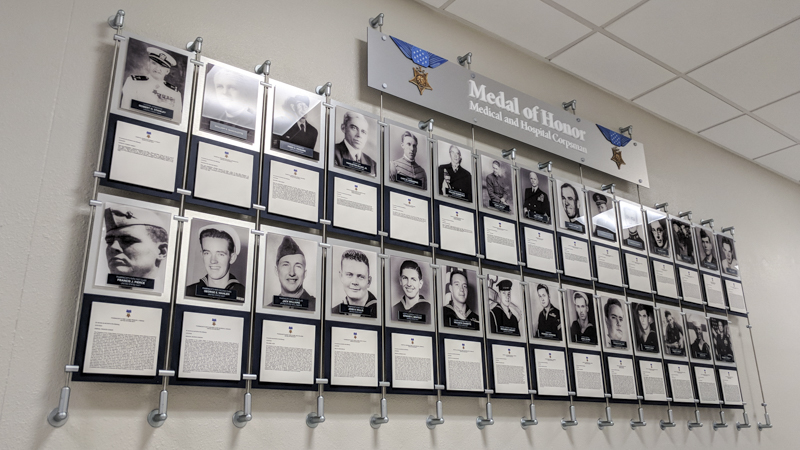 Naval Medal of Honor tribute display with photo frames and information panels